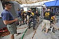 US Navy 110611-N-WL435-011 Navy divers and U.S. Army divers dress out divers and conduct pre-dive checks before a diving exercise to raise a sunken.jpg