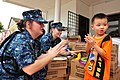 US Navy 110906-N-TO930-085 Sailors make shapes out of Play-Doh with a resident of the Rumah Juara children's home.jpg