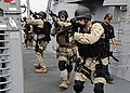 US Navy 111108-N-VH839-019 Fire Controlman 3rd Class Matthew Keen leads his visit, board, search, and seizure (VBSS) team members to the forecastle.jpg