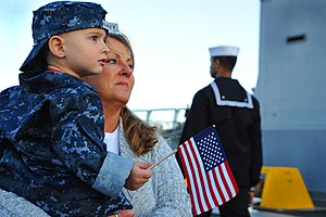 US Navy 111214-N-AW702-003 The family of a Sailor waits for the USS Samuel B. Roberts to dock.jpg