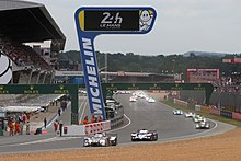 The start of an automobile endurance race at the Circuit de la Sarthe