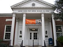 "picture of a front entrance of a building with columns which says ""United States Post Office, Summit NJ 07901."