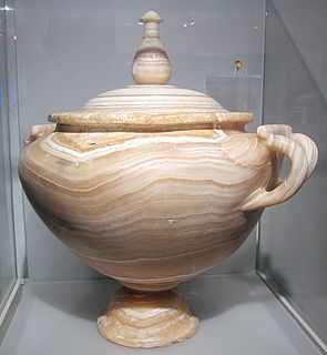 Urn Vase, often with a cover, with a typically narrowed neck above a rounded body and a footed pedestal
