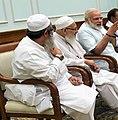 Usman Mansoorpuri with Modi and Mahmood Madani.jpg