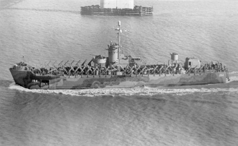 USS LSM(R)-194, of the LSM(R)-188 Class, passing under the Cooper River Bridge, Charleston, SC, 2 December 1944.