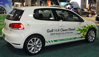 """Volkswagen emissions scandal - A 2010 Volkswagen Golf TDI with defeat device displaying """"Clean Diesel"""" at a US auto show"""