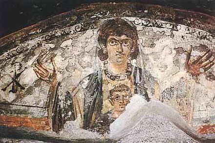 Virgin and Child. Wall painting from the early catacombs, Rome, 4th century. VirgenNino.jpg