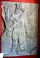 Wall panel. Human-headed and winged Apkallu holding a bucket and cone. From Nimrud, Iraq. 9th century BCE. Pergamon Museum, Germany.jpg