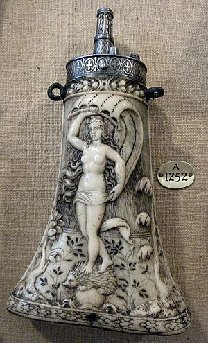 Powder flask - German antler and steel flask, c. 1570; the goddess Fortuna stands on a hedgehog upon a globe