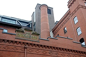 Weinhard Brewery Complex - Detail view of signage and deco-rative brickwork on the west façade and also the north façade of the six-story Malt House and Hop Building