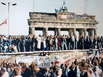 The fall of the Berlin Wall in 1989 led to the reunification of East and West Germany. Thefalloftheberlinwall1989.JPG