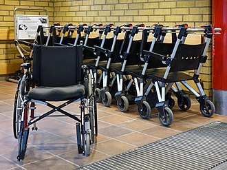 Wheelchair - Folding chair and stackable rigid chairs for visitors in NÄL hospital, Sweden