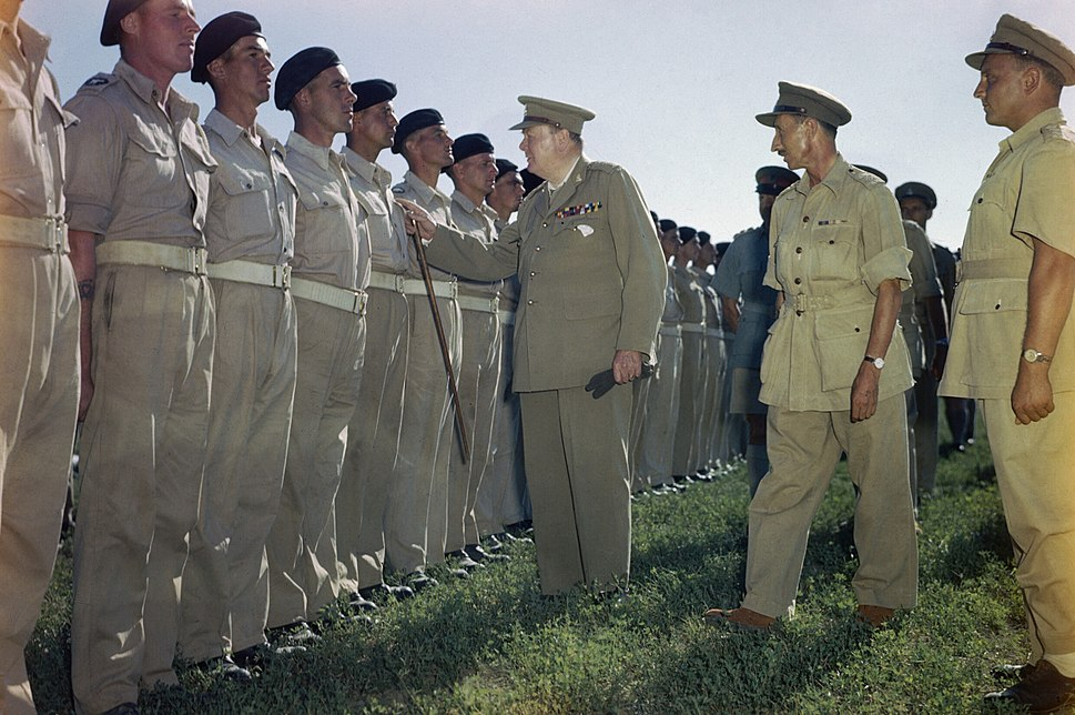Winston Churchill inspecting men of the 4th Queen%27s Own Hussars at Loreto aerodrome, Italy, 25 August 1944. TR2275