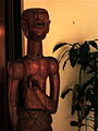 Wooden sculpture of man at embassy of ghana 2011.jpg