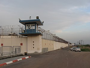 Physical security - Modern prisons are among some of the most physically secure facilities, with almost every area under tight access control and surveillance. Pictured here is the exterior of Shata Prison in Israel, which is secured through the use of high fences, razor wire, protective barriers, guard towers, and security lighting.