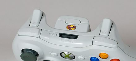 "Shoulder buttons (""bumpers"") and triggers on an Xbox 360 controller. Xbox360 controller white back.jpg"