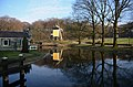 Yellow windmill and reflection at Open Air museum Arnhem - panoramio.jpg