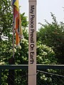 """""""May Peace Prevail on Earth"""" sign in front gate of Lumbini Nepal.jpg"""