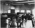 (Equipment resting on saw horses in metal shop at Submarine Base, Los Angeles.) - NARA - 295472.tif