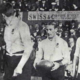 Herbert Moran -  Moran leads the Wallabies out in the 1st match of the 1908 Tour at Devonport.