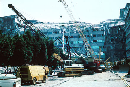 Mexico city - Collapsed upper stories and construction equipment at work at the Ministry of Telecommunications and Transportation building. 1985 Mexico Earthquake - Ministry of Telecommunications and Transportation building.jpg