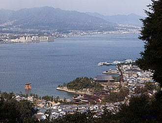 Battle of Miyajima - View of Miyajima shore, with Itsukushima torii at left, and mainland in the distance (2012).