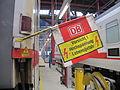 2013-09-15 12-54-00 Bw Basel Bpmz Wagen mit Signalflagge Vorsicht Hochspannung Lebensgefahr.jpg