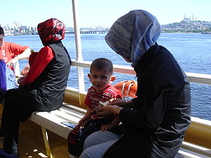 Istanbul - Muslim women and a child on the boa...
