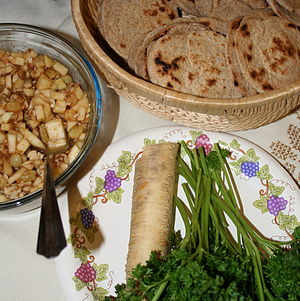 Karpas - Karpas (here parsley), on a Seder table, along with matzo (unleavened bread), maror (bitter herbs, here horseradish) and charoset