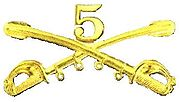 A computer generated reproduction of the insignia of the Union Army 5th Regiment cavalry branch. The insignia is displayed in gold and consists of two sheafed swords crossing over each other at a 45 degree angle pointing upwards with a Roman numeral 5