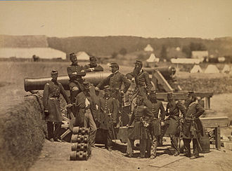 Michael Corcoran - Officers of the 69th New York Volunteer Regiment pose with a cannon at Fort Corcoran in 1861. Michael Corcoran at left