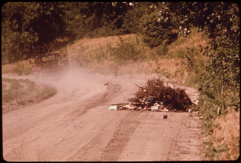 File:ANONYMOUS DRIVER DUMPS A PICK-UP LOAD OF TRASH ON A FARM ROAD NEAR BONNER SPRINGS - NARA - 552079.tif