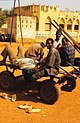 ASC Leiden - W.E.A. van Beek Collection - Dogon markets 34 - Men on a flat cart waiting for freight at the edge of the market of Mopti, Mali 1996.jpg