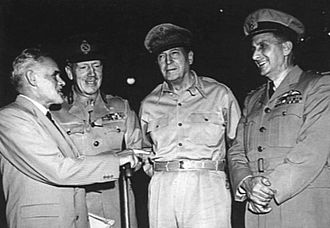 George Jones (RAAF officer) - Lieutenant General Sir Horace Robertson (second left), General Douglas MacArthur (second right) and Air Marshal Jones (far right) in Japan after the outbreak of the Korean War in 1950