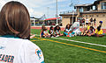 A Miami Dolphins cheerleader, foreground, watches Natalie W, also a Miami Dolphins cheerleader, interact with children during a community visit at Naval Station Guantanamo Bay, Cuba, Feb 120205-A-FD963-055.jpg