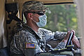 A Soldier with Charlie Company, 4th Battalion, 118th Infantry Regiment, 218th Maneuver Enhancement Brigade, drives a Humvee while responding to a simulated dirty bomb attack during Exercise Palmetto Response 110612-A-DH163-045.jpg