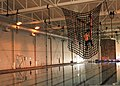 A U.S. Navy SEAL candidate hangs onto a suspended cargo net while navigating an elevated obstacle course at Joint Expeditionary Base Little Creek-Fort Story, Va., May 11, 2013 130511-N-OH262-954.jpg