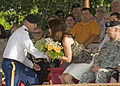 A U.S. Soldier presents Brook Lynn, center, wife of U.S. Army Brig. Gen. Alan R. Lynn, with a bouquet of flowers, during Signal Center commanding general change of command ceremony, on Fort Gordon, Ga., July 21 100721-A-NF756-012.jpg
