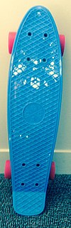 A blue deck of a penny board.JPG