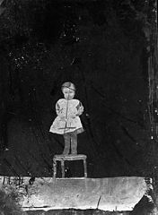 A child standing on a chair