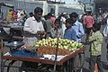 A fruit vendor at Charminar market, in Hyderabad on January 9, 2006.jpg
