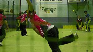 Indoor cricket - A bowler bowling to a batsman.