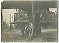 African American worker at a work site near the Trenton Elevated Railroad Bridge in Philadelphia. (18960275913).jpg