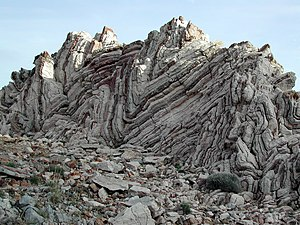 Fold (geology) - Folds in alternating layers of limestone and chert in Crete, Greece.
