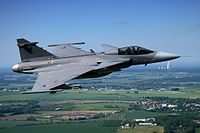 Air-to-air with a Czech Saab Gripen with AFB Čáslav in the background.jpg