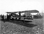Aircraft, probably a Curtiss JN-4 known as The Jenny, on unidentified airfield, ca 1919 (TRANSPORT 16).jpg