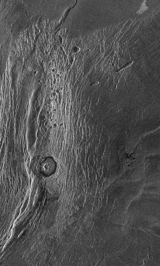 Akna Montes - Magellan radar image of the northern portion of the Akna Montes. The round feature is the crater Wanda.