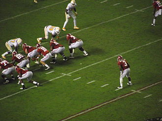 2011 Alabama Crimson Tide football team - AJ McCarron takes a snap with Trent Richardson in the backfield against the Tennessee defensive line.