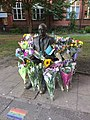 Alan Turing's statue surrounded by flowers on his birthday 2018.jpg