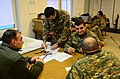 Albanian soldiers plan for an upcoming mission during a military adviser team (MAT) and police adviser team (PAT) training exercise at the Hohenfels Training Area, a part of the Joint Multinational Readiness 131213-A-LO967-00113.jpg